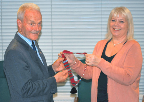 Arthur Murray receives President's chain of office from Sandy Leong